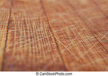 Wooden background. Wood texture. Close-up scratched wooden kitch