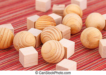 Wooden balls and cubes