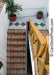 banister and tiled stairway