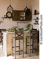 Wooden bar counter with wooden chairs in the interior of the kitchen dining room in the Scandinavian style