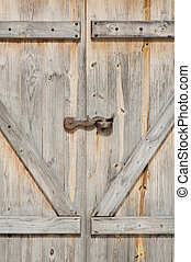 Wooden barn door closed in the farm