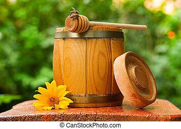 barrel of honey - wooden barrel of honey with drizzler and...