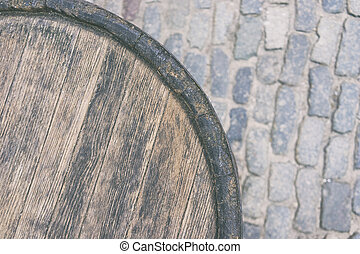 Wooden barrel on the street - Wooden old barrel against the ...