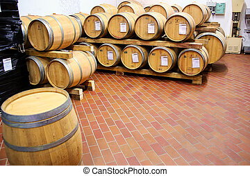 Wooden barrels in a wine cellar in Montalcino, Val d'Orcia, Tuscany, Italy