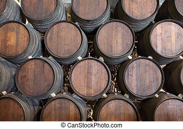 Wooden barrels in a wine cellar