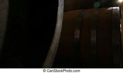 Wooden Barrels In An Old Wine Cellar