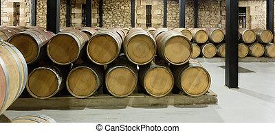 wooden barrels in rows