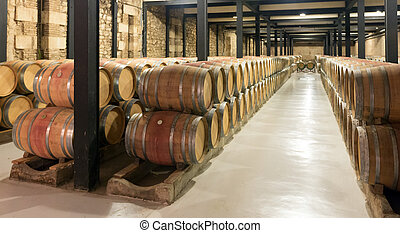 wooden barrels in  winery factory