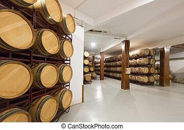 wooden barrels in  winery