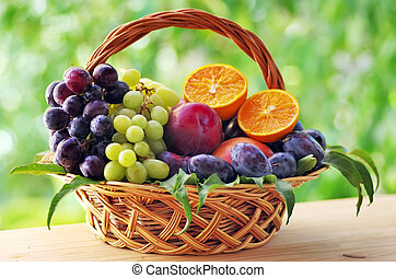 wooden basket full of fruits on table