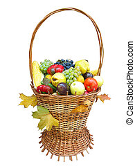 wooden basket with autumn harvest fruit vegetables and leaves isolated