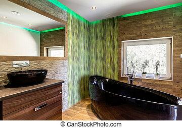 Wooden bathroom with black details idea