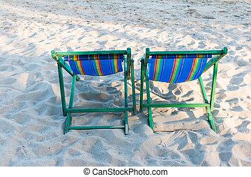 wooden beach chair at the beach