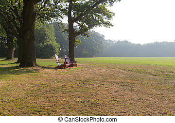 Wooden beach chairs in rural landscape of the Netherlands