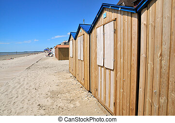 Wooden beach huts with blue roof