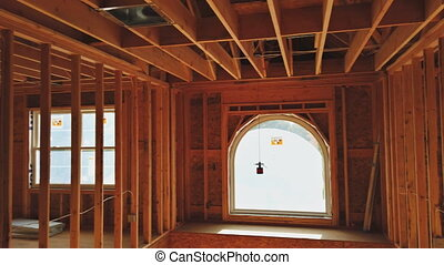 NewYork NY US. 02 MAY 2020: Wooden beams and wall to ceiling framed building under construction interior residential home