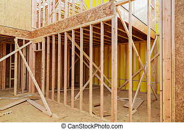 wooden beams at construction interior frame of a new house under construction