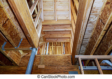 wooden beams at construction new residential house framing