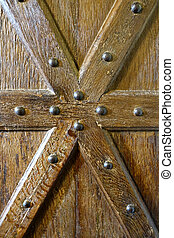 Wooden beams bolted to door to make star shape