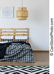 Wooden bed and beding - Wooden bed with black and white...