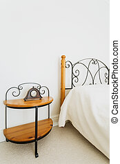 Wooden bed and nightstand with ornamental iron elements