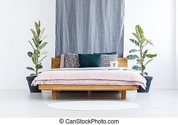 Wooden bed in bedroom interior