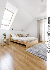 Wooden bed in cozy bedroom - Comfortable king size wooden...