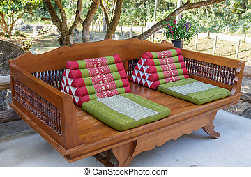 Wooden bed under tree - Wooden bed with thai pillow under...