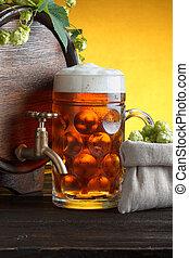 Wooden beer barrel with fresh hop