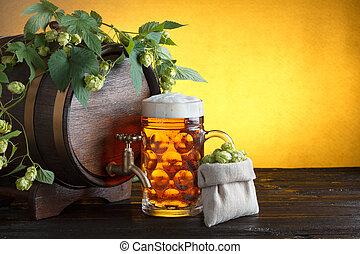 beer barrel with fresh hop
