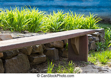 wooden bench and blue wall - wooden bench on a background of...