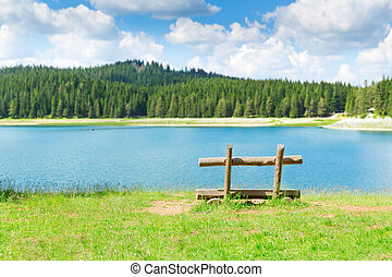 Wooden bench at the lake