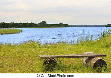 Wooden bench by the lake