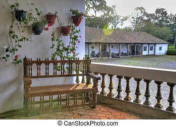 Wooden bench in an old hacienda - Old wooden bench on a...