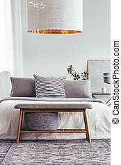Wooden bench in designer bedroom