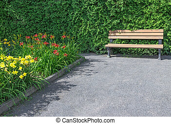 Wooden bench in the flowering garden