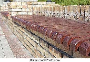Wooden bench in the garden patio.