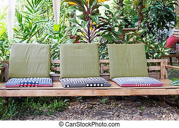 wooden bench in the garden