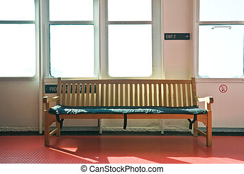 wooden bench in the interior lit by bright sunshine