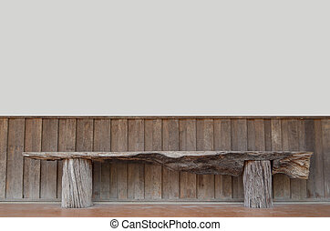 wooden bench on a wall.