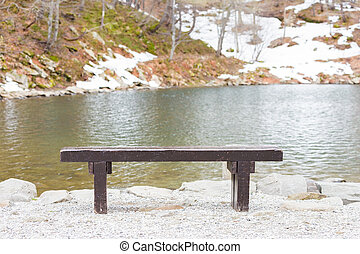 wooden bench on the lake