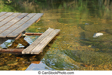 Wooden bench on the lake, Thailand