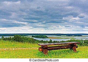 Wooden bench on the shore of Lake Braslav