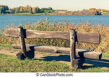 Wooden bench with a lake view