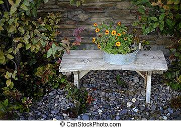 Wooden Bench with Flower Arrangement Garden
