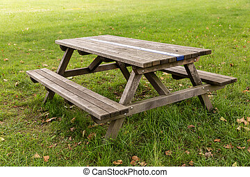 Wooden bench with table