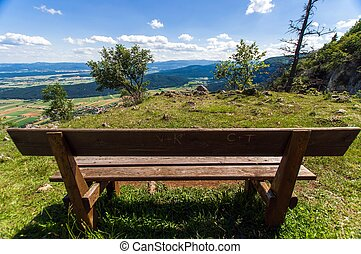 Wooden bench without people outdoors