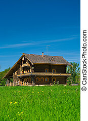Wooden big house from timbers and windows on it. It is in a ...
