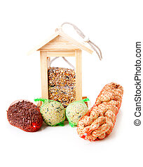 wooden bird feeder house with food