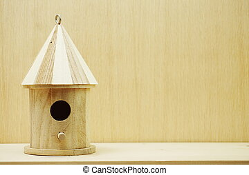 wooden bird house with space copy on wooden background